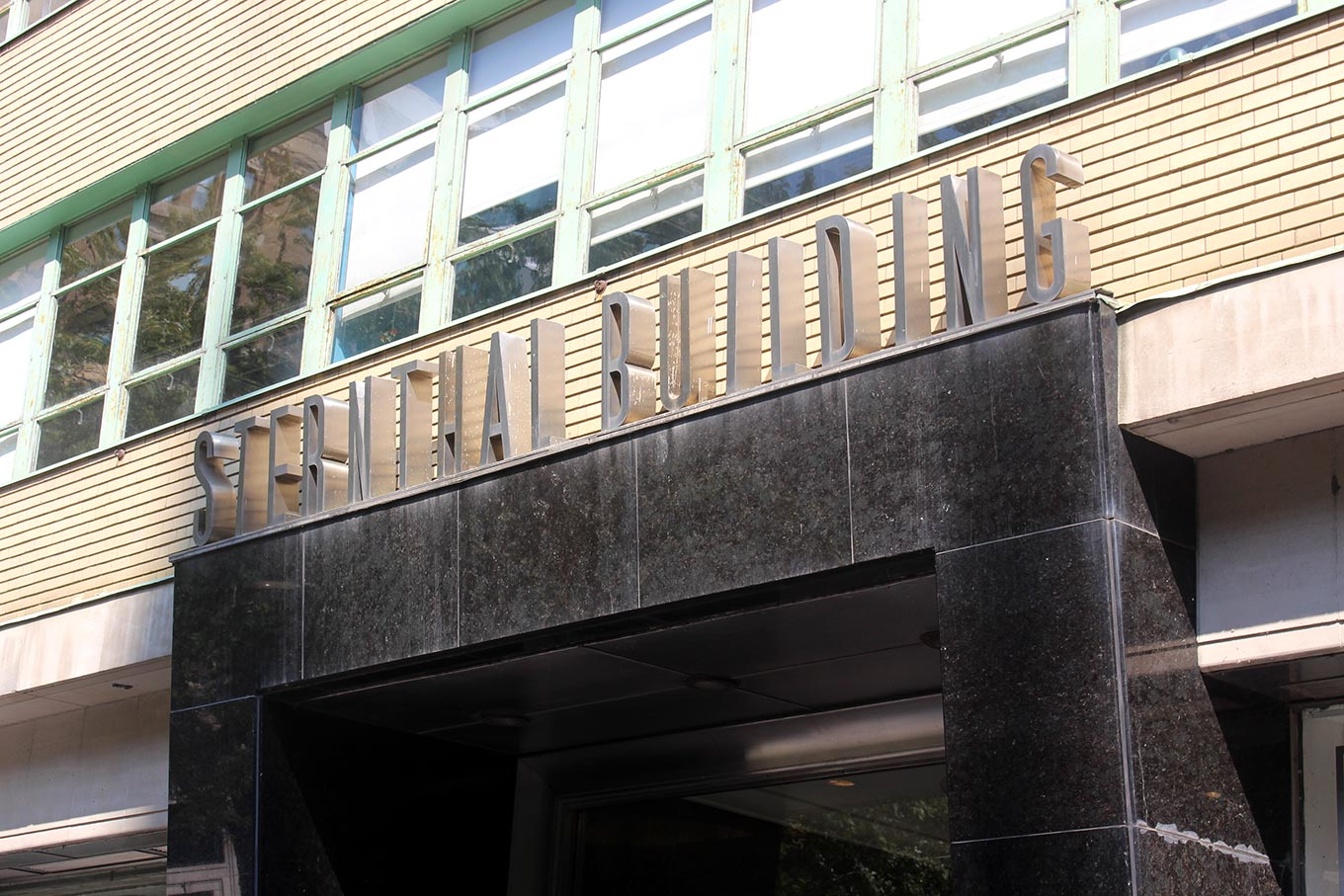 Fabricated stainless letters above the Sternhall Building entrance.