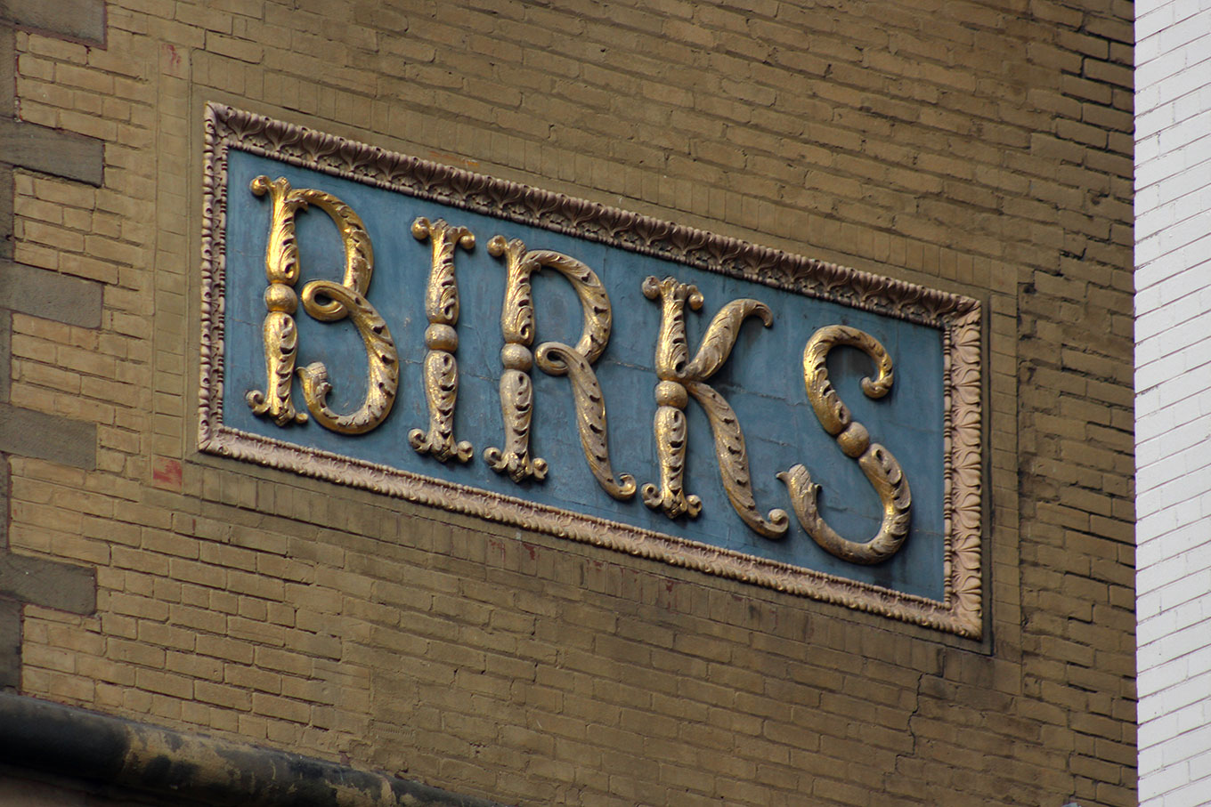 Enormous expressive letters on the side of the Birks Building on Phillips Square.