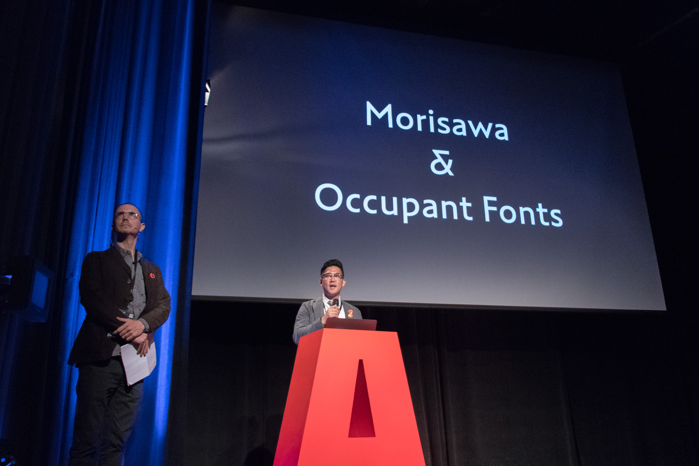 Tetsuo Sakomura takes the stage at ATypI 2017 Montreal, accompanied by Cyrus Highsmith